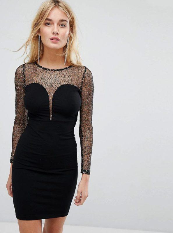 Девушка в черном коктейльном платье со стразами