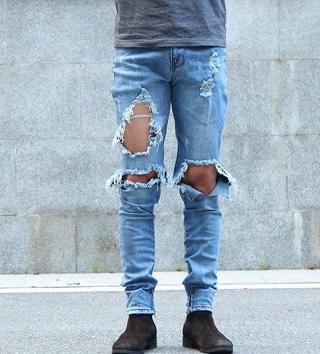 Тонкие рваные джинсы