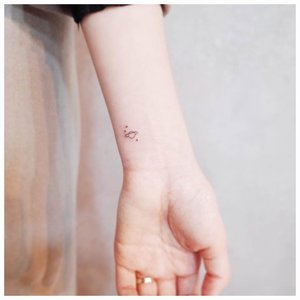 Аккуратная маленькая татуировка