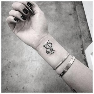 Анималистическое тату на руке