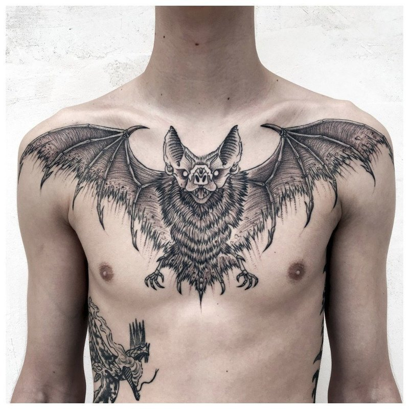 Животная тематика тату мужчине на грудь