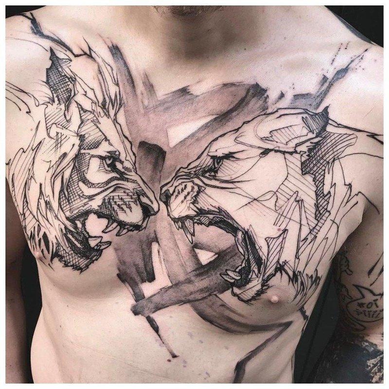 2 разъяренных животных - тату у мужчины на груди