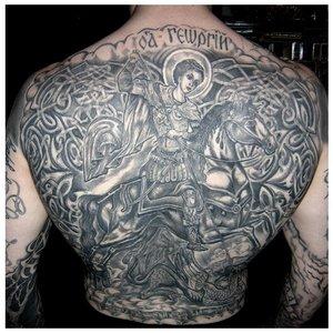 Тату на спине с религиозной тематикой