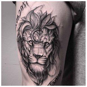Тату льва в стиле лайнворка