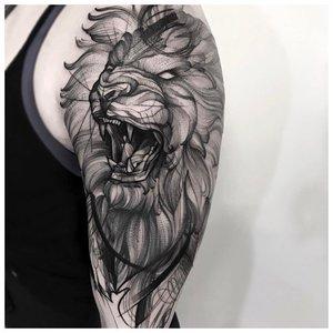 Тату рычащего льва