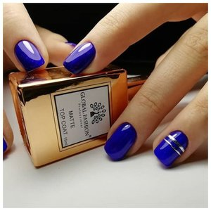Синий маникюр с золотыми лентами