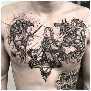 Татуировка Анубиса на груди в стиле лайнворк
