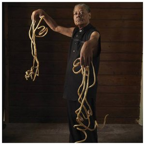 Мелвин Бут - мужчина с самыми длинными ногтями в мире