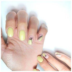 Пастельно-желтые ногти с одуванчиками