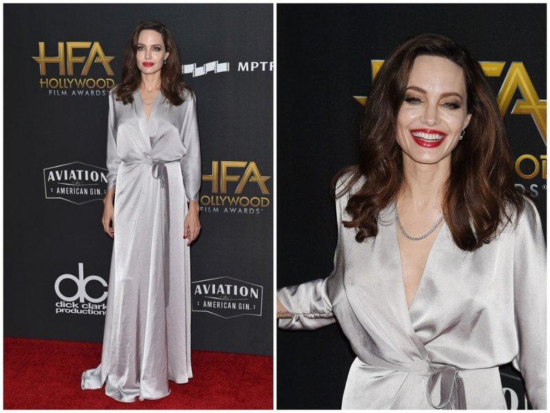 Джоли в платье с запахом серого цвета