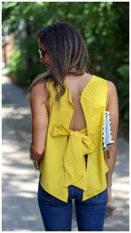 Желтая блузка оригинального кроя