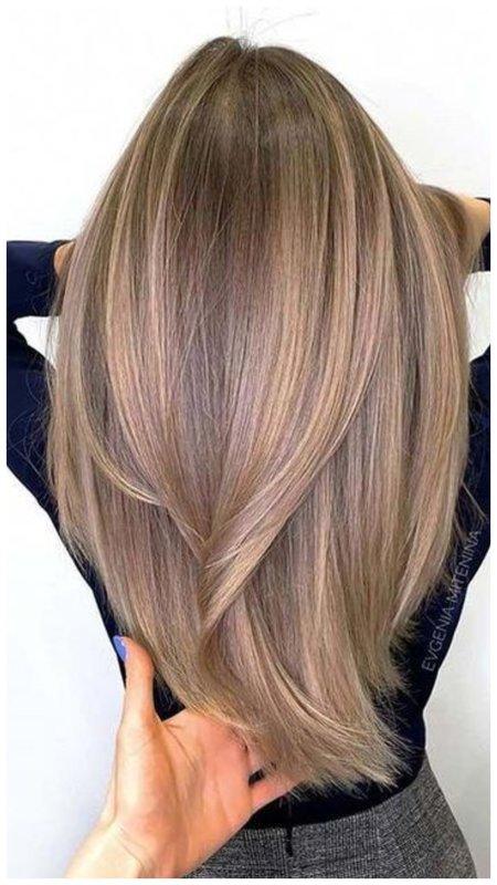 Длинные волосы с мелкими светлыми прядками
