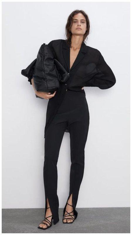 Черные брюки с разрезами