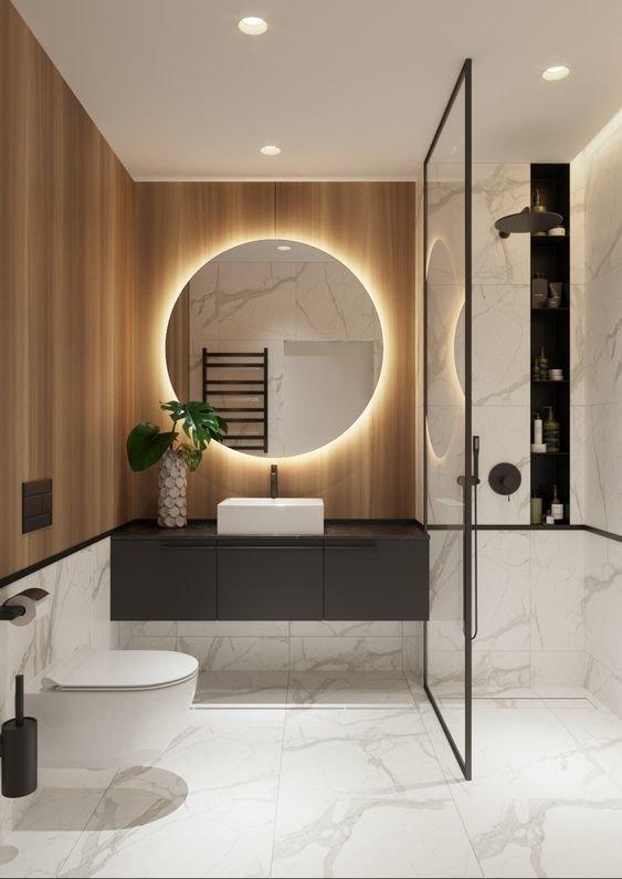 Ванная комната с круглым зеркалом
