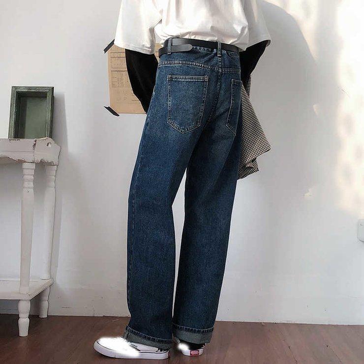 Мужские джинсы на женщине