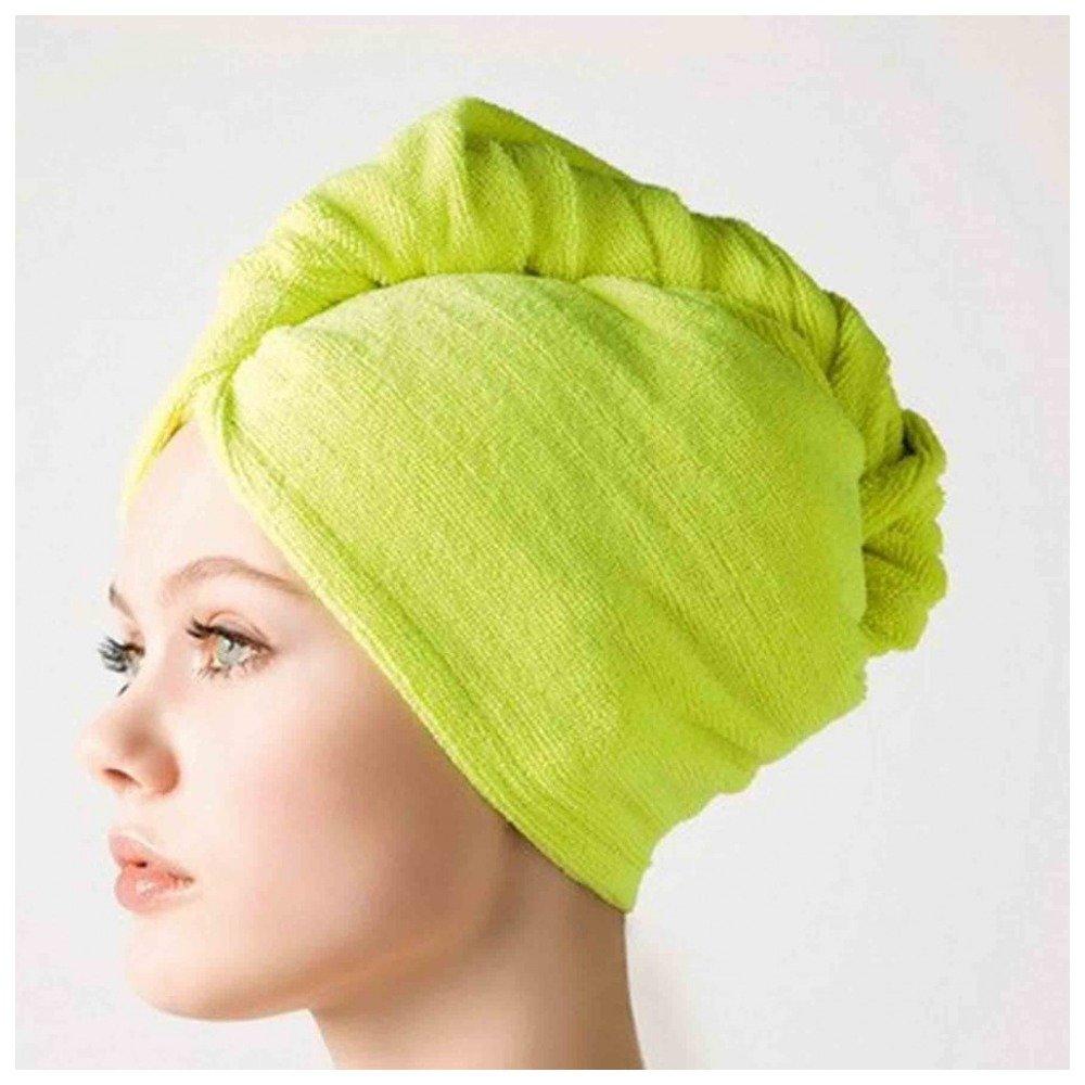 Полотенце на волосах